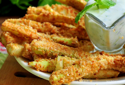 Zucchini sticks with cheese and garlic